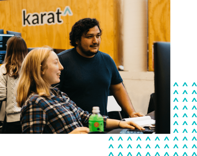 TWo Karat software engineers working in the office.
