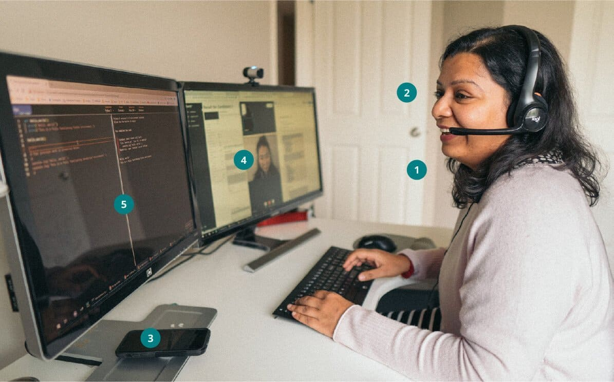 Person wearing headset on computer.